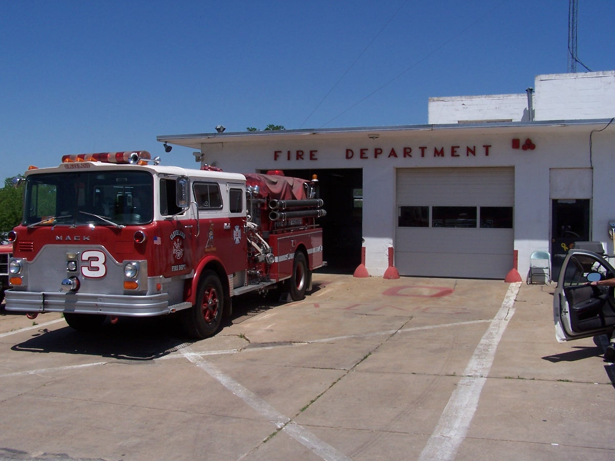 A fire truck sitting in front of a Fire Department garage